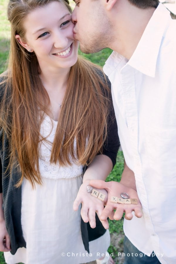 a couple holds their wedding rings for an anniversary portrait by Belle Plaine Wedding Photographer