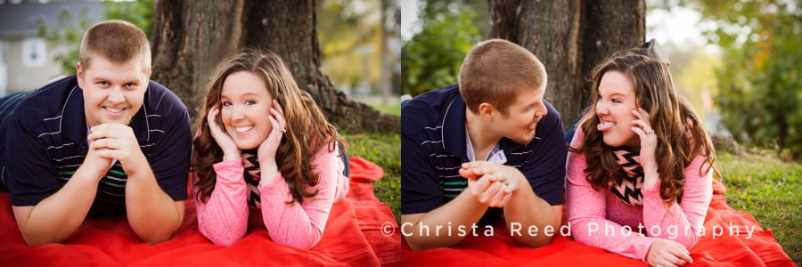 a couple sits under a tree in the fall for engagement pictures