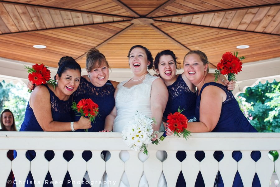 navy blue bridesmaid dresses and red bouquets for a fourth of July wedding