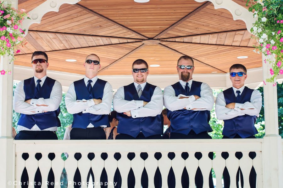 groomsmen wear navy blue vests for a fourth of july wedding