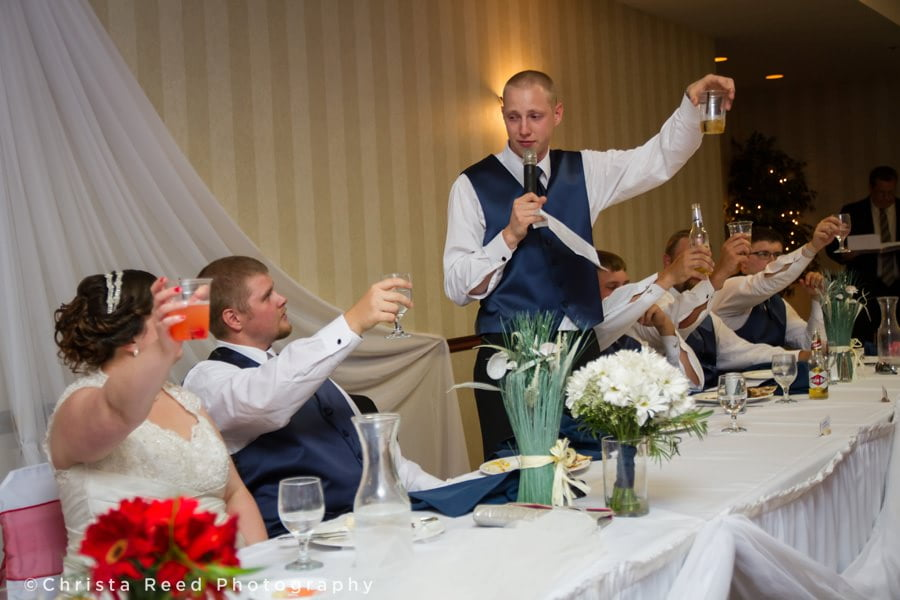 best man gives a toast to the couple