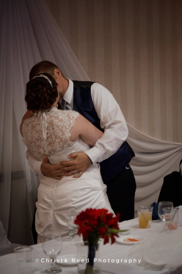 a romantic kiss at the wedding reception