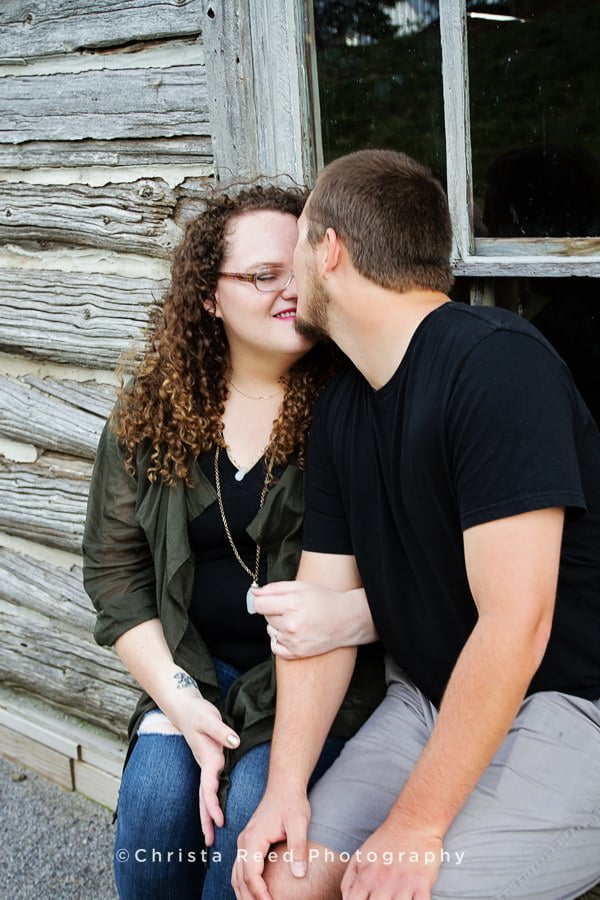 a couple having a romantic moment at their Minnesota state fair engagement shoot