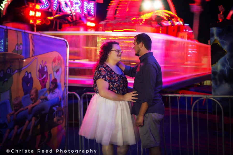 night time portraits on the midway for a Minnesota state fair engagement shoot