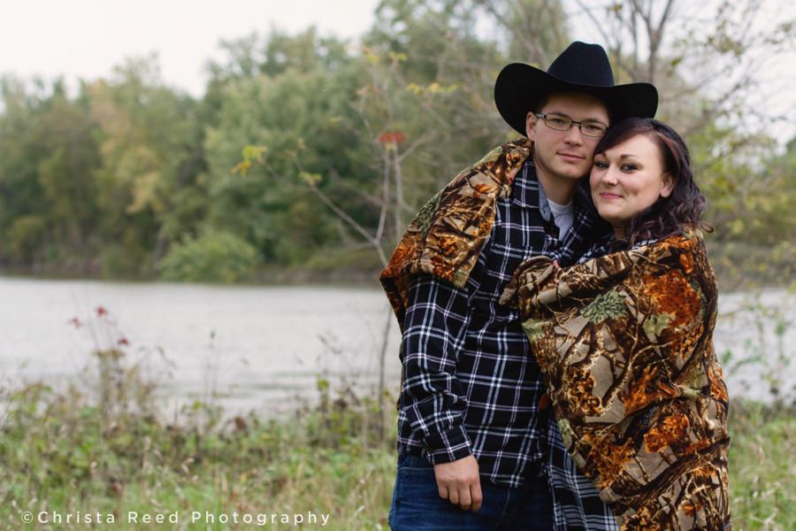 romantic cowboy engagement with camo blanket