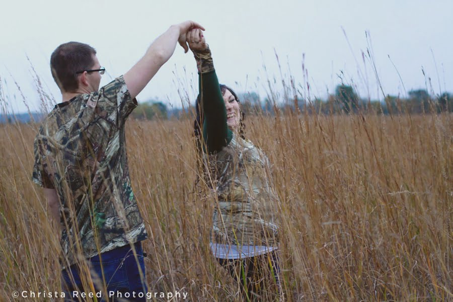 engagement portraits dancing in a field in chaska