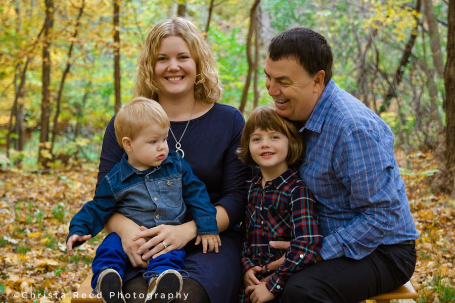 family laughing together at their portraits in chanhassen