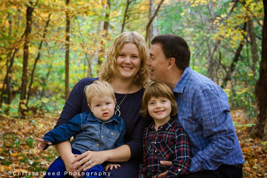 dad kisses mom for portraits in chanhassen