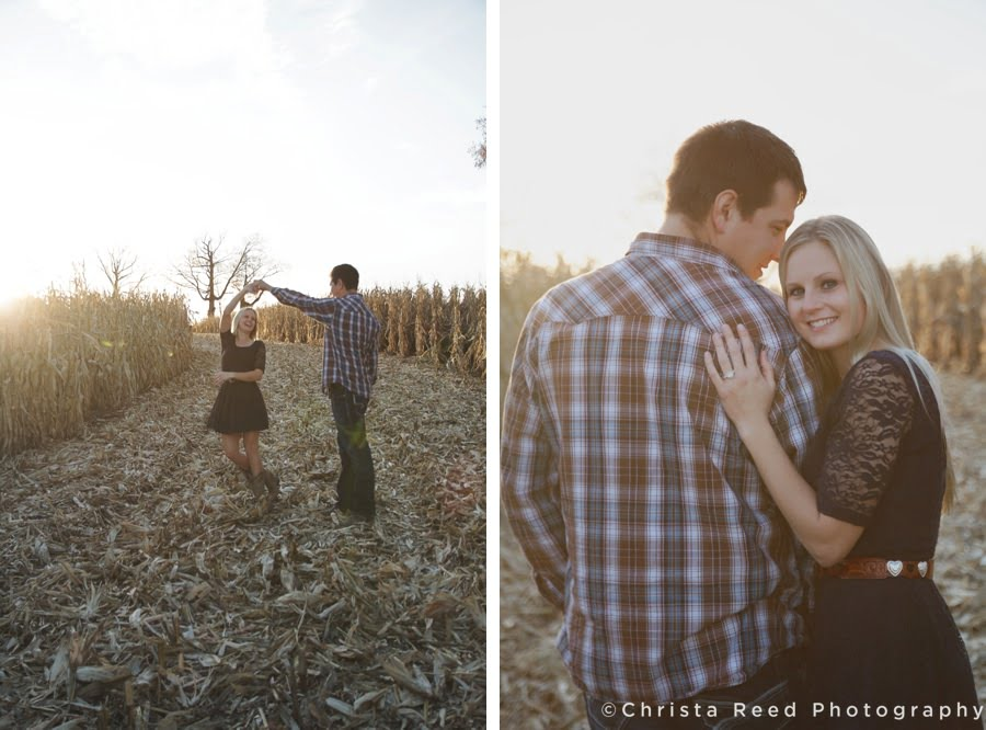 engaged couple dances together in the cornfield