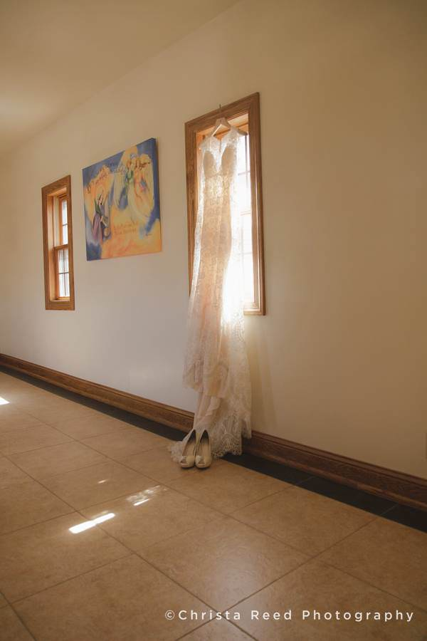 Wedding dress in a window by Mankato wedding photographer
