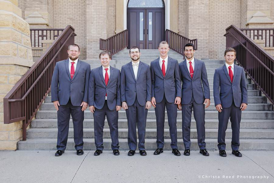 groomsmen wear red ties for a fourth of July wedding in Mankato