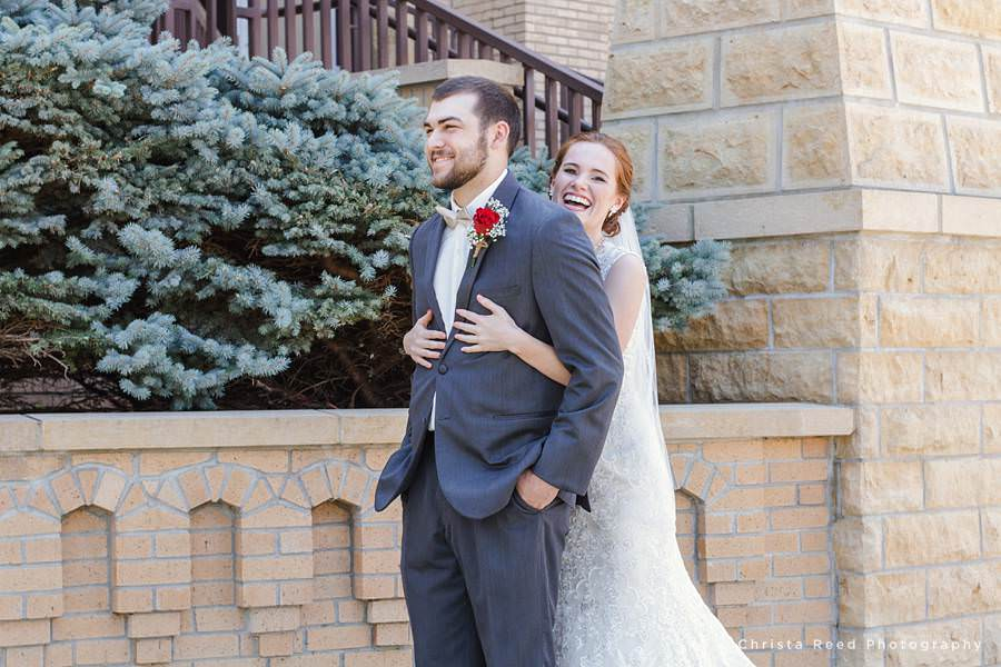bride hugs her groom before their wedding in mankato