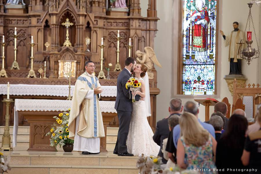 bride and groom share first kiss after wedding in mankato