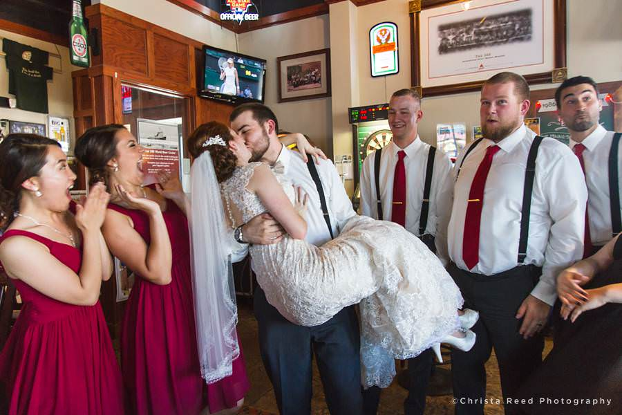 kissing bride and groom at mankato 500 pub
