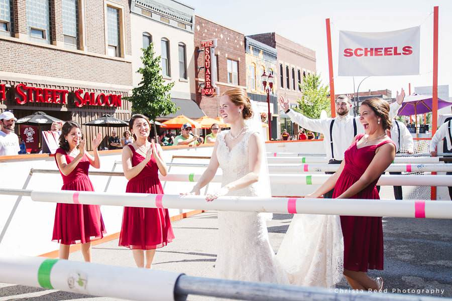 wedding party plays human foos ball outside 500 pub in mankato