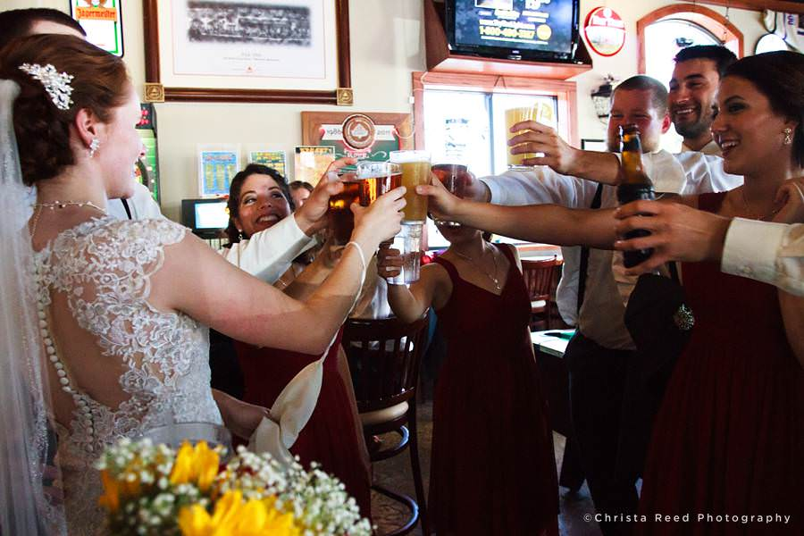 wedding party toast with pints at 500 pub