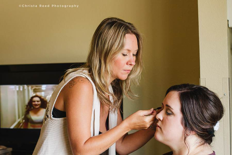 bride getting her make up done at Chanhassen hotel