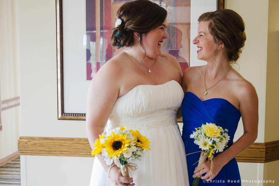 bride with maid of honor smiling together