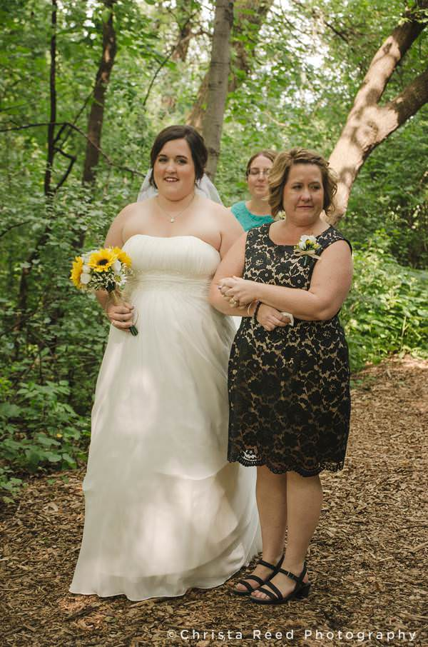 bride with mother waiting to walk down aisle