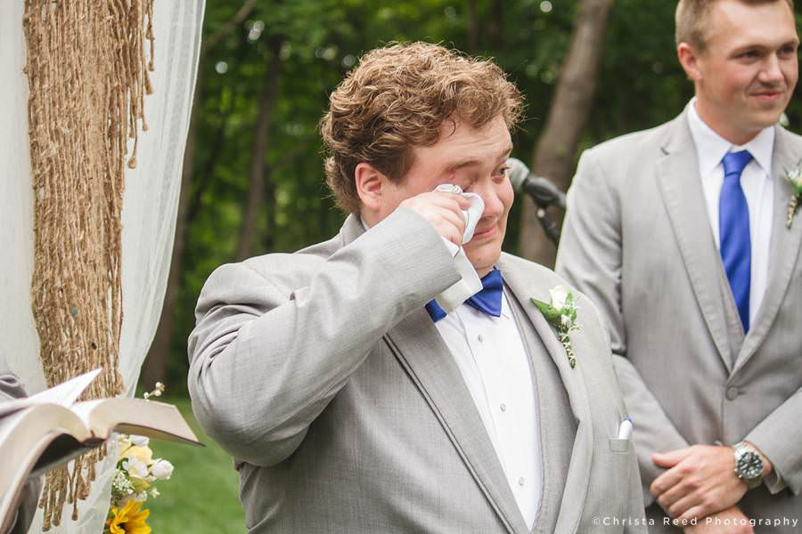 groom wipes his tears