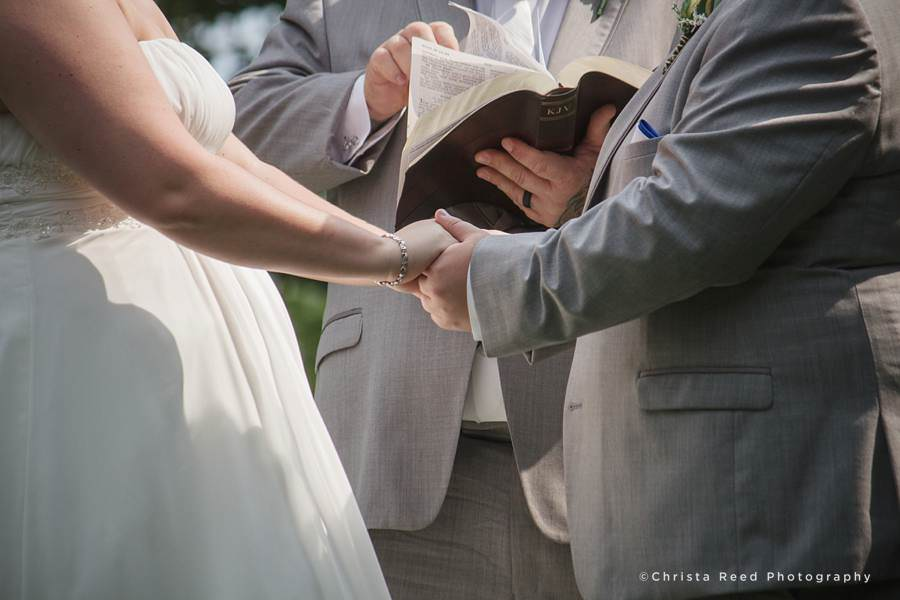 holding hands during wedding ceremony