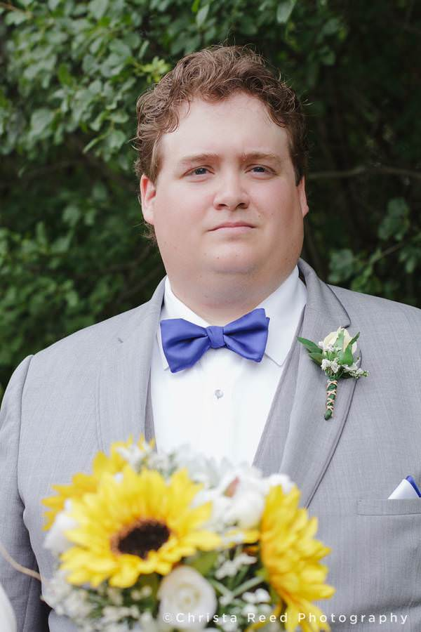 portrait of groom with a serious expression
