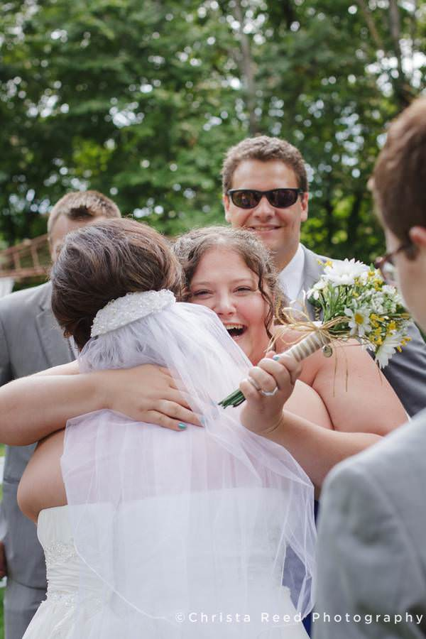 friends congratulate bride after wedding