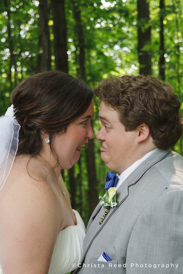 bride and groom make funny faces together
