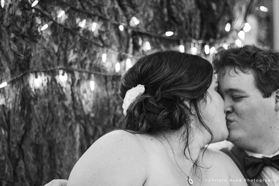 couple kisses outside at night