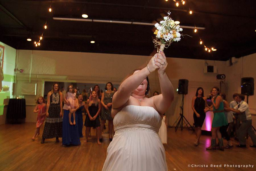 bouquet toss at chanhassen dinner theatre wedding reception