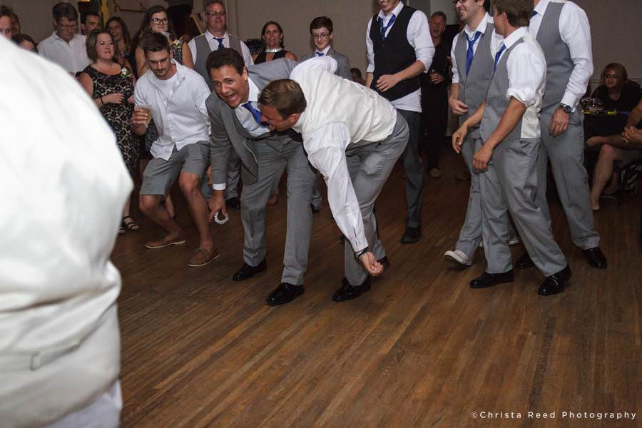 groom's friend catches garter