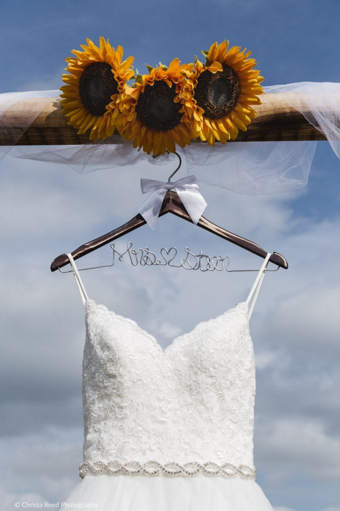 fancy wedding dress hanger and sunflowers for a belle plaine minnesota wedding