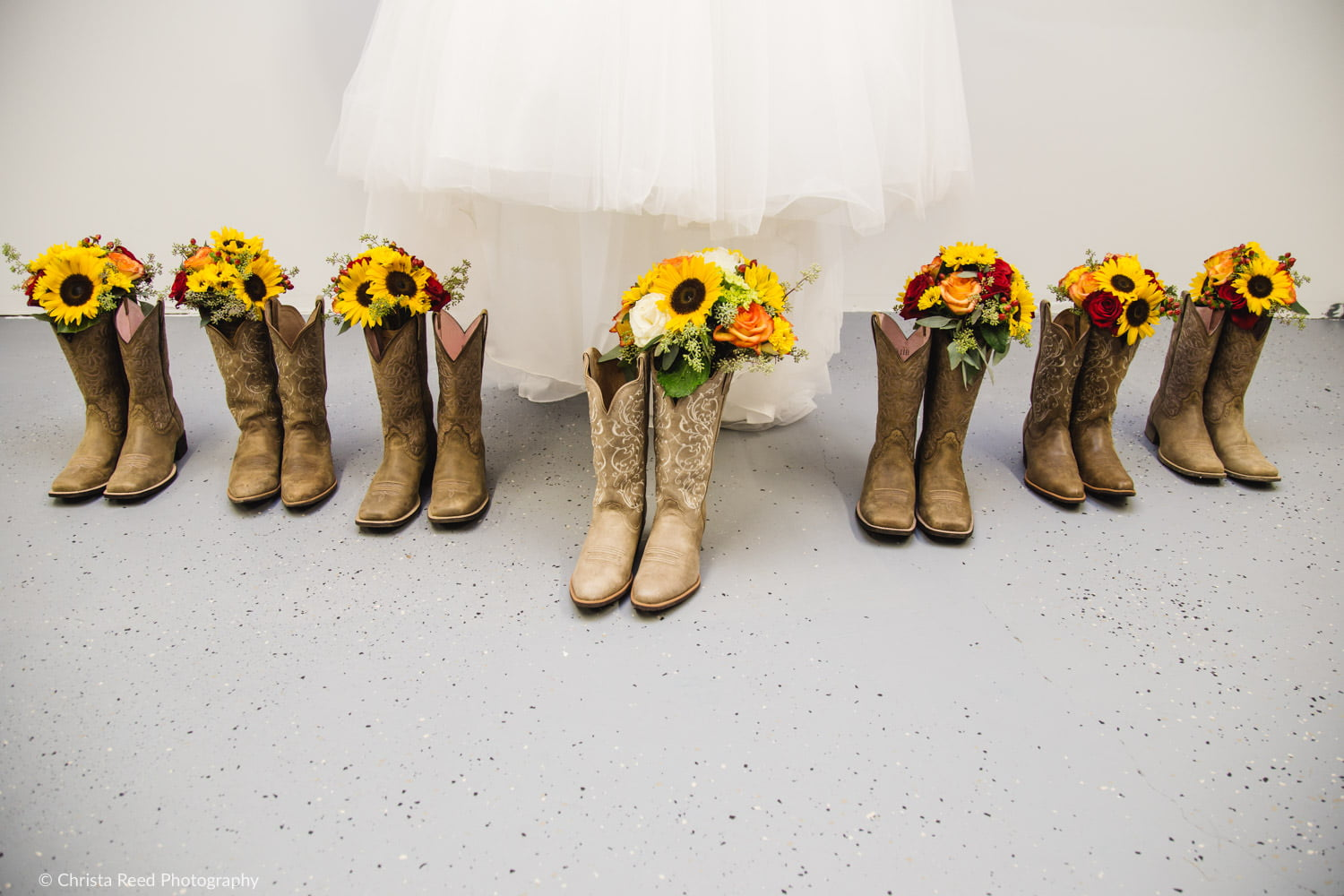 cowboy boots and sunflower bouquets for a farm wedding in belle plaine minnesots