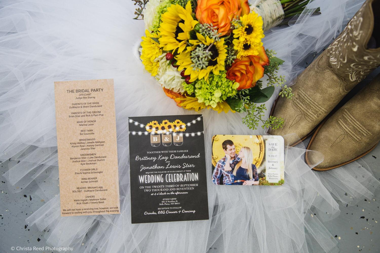 custom wedding invitations and sunflower bouquet for a farm wedding in minnesota