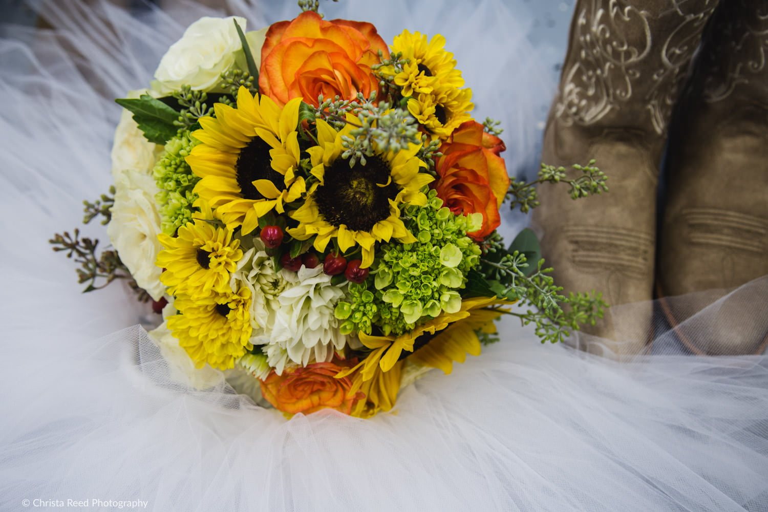 fresh sunflower bouquet and cowboy boots for a Minnesota farm wedding in belle plaine