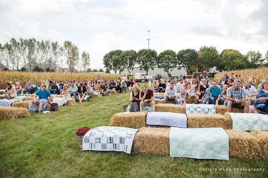 hay bales and quilts for a farm wedding in minnesota