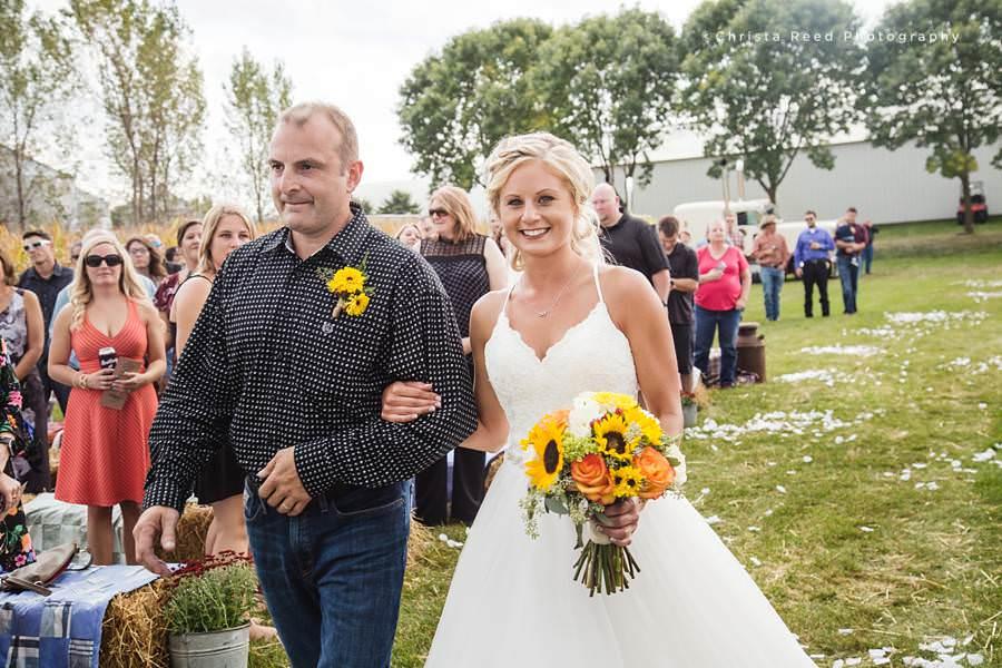 bride walking down the aisle at her cornfield wedding in belle plaine minnesota