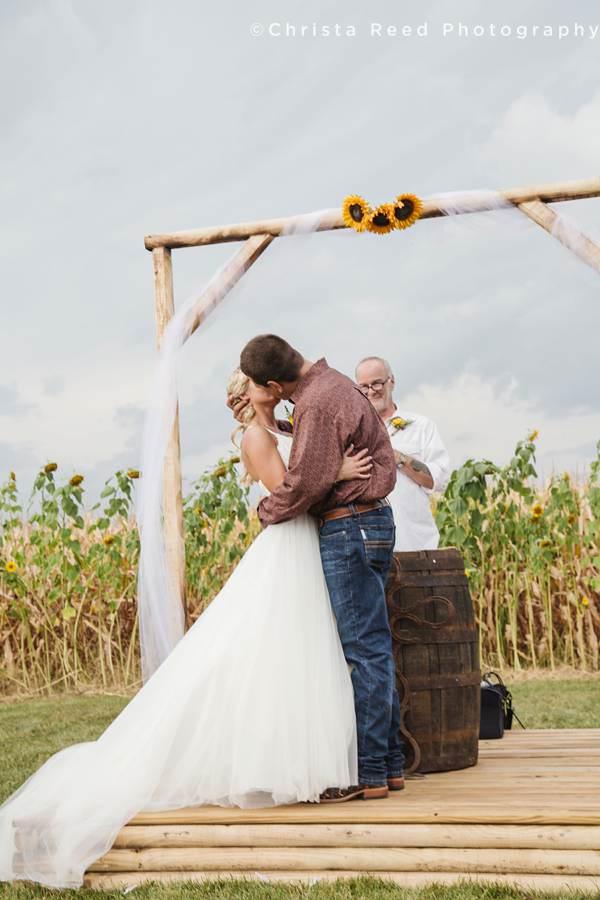 first kiss farm wedding cornfield in minnesota