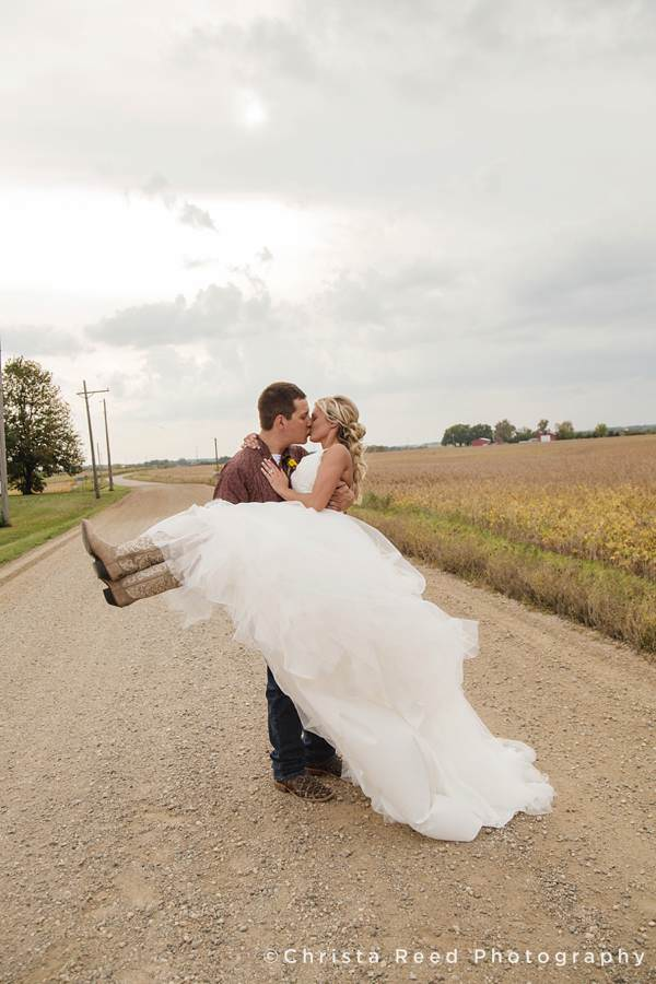 kissing on a country road for a minnesota farm wedding