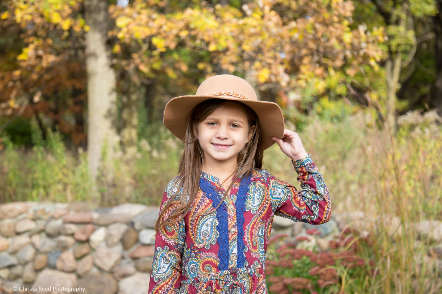 portrait of a girl in a hat and paisley dress