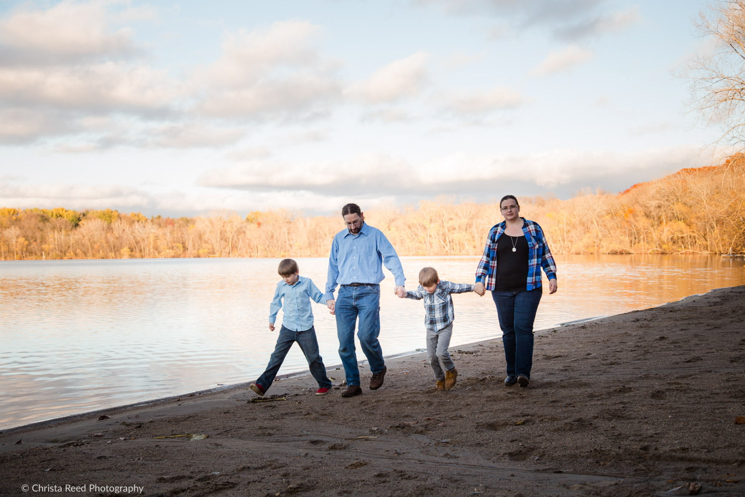family walking on the beach at lake ann park in chanhassen for portraits