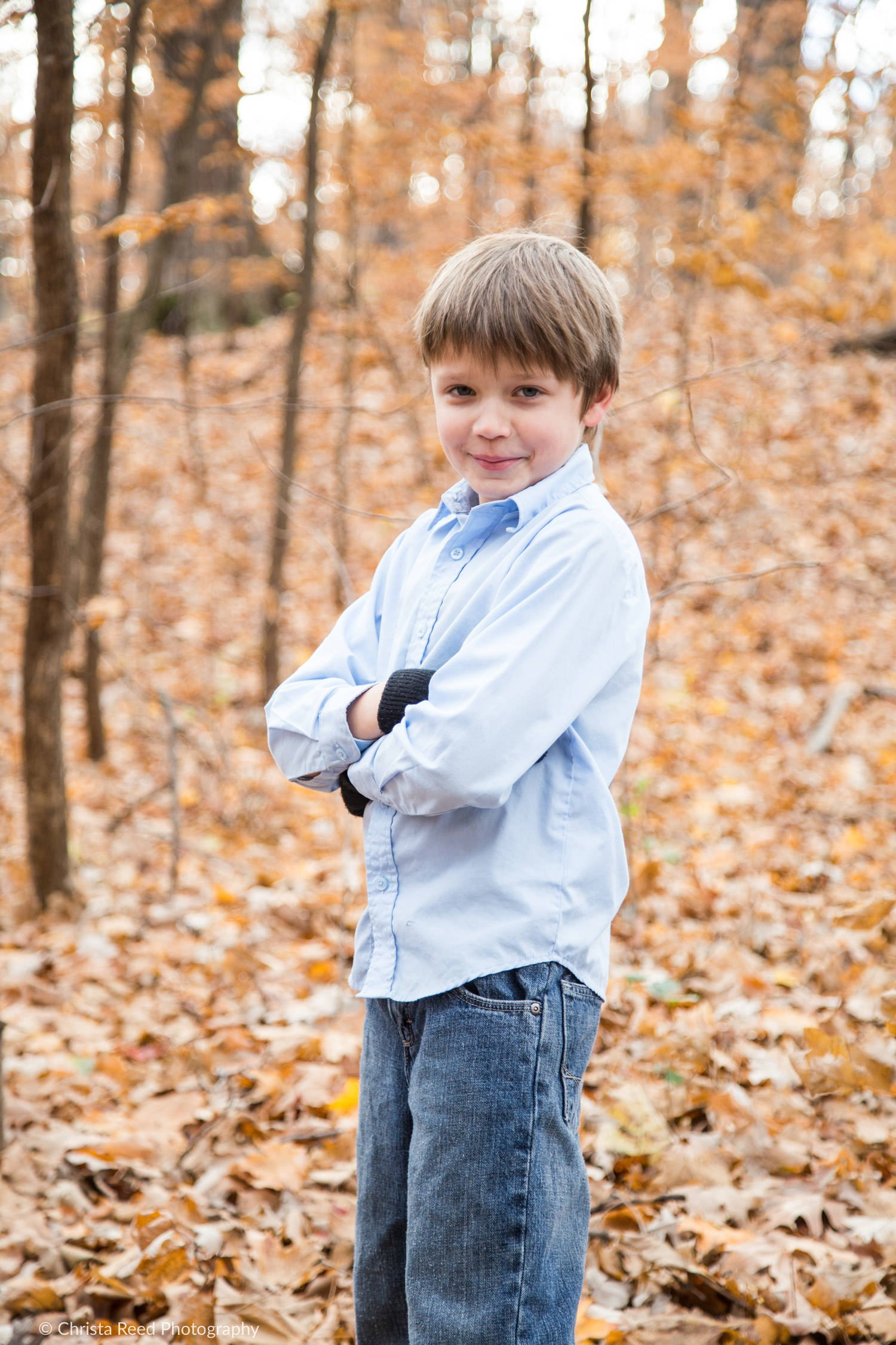chanhassen fall portraits in the woods with a school age boy