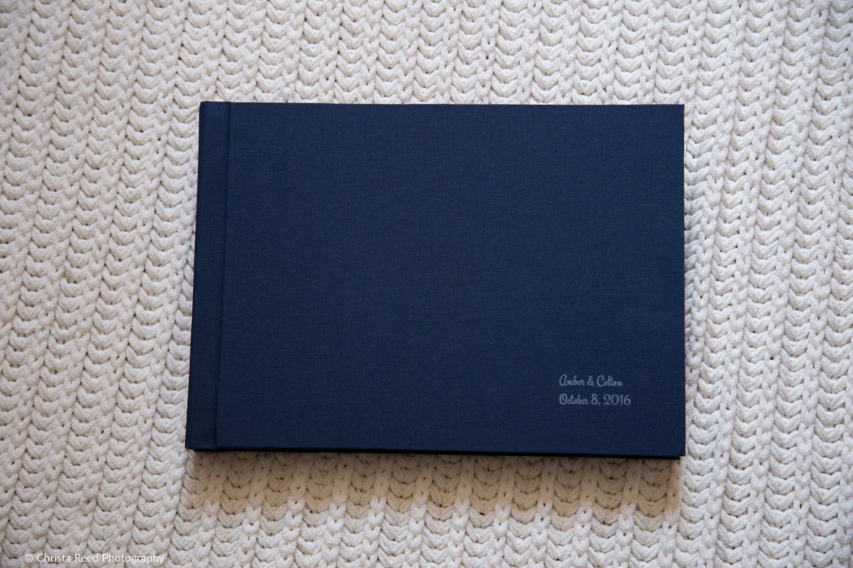 navy blue linen cover of a wedding album by chaska mn wedding photographer