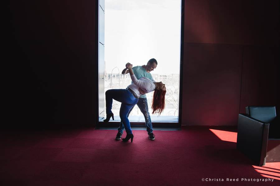 a couple does a dramatic dip for their Guthrie Theatre Engagement pictures