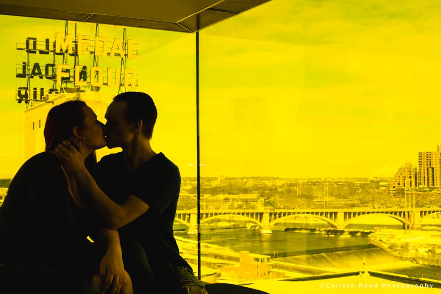 a romantic kiss with the gold medal flour building in the background Guthrie Theatre Engagement pictures