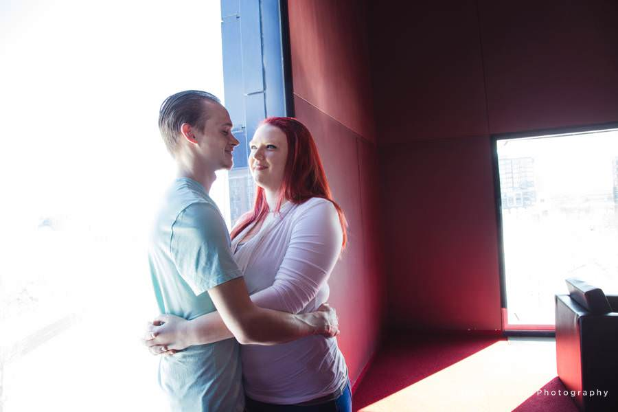 a couple holds each other close for their Guthrie Theatre Engagement pictures
